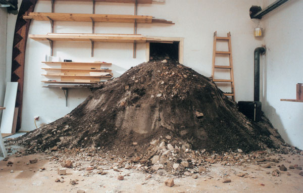 Hans Schabus - The Shaft Of Babel (2003). Over days, Schabus digged a 15 feet deep hole in his atelier and shifted the earth to a pile