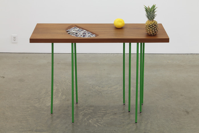 darrenbader Virginia, 2011 Table with condoms and pineapple and grapefruit