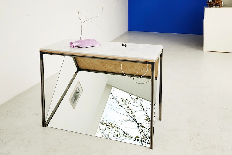 Navid Nuur 'Wiki Table', 2012-2013 metal, marble, magnet, mirror, hot-water bottle, vitamin D, medallion, aluminum wire, linking ring